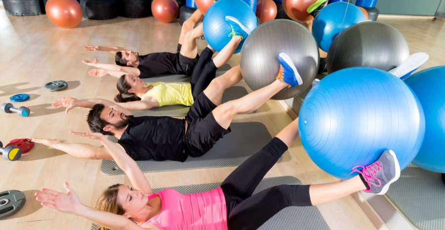 Fitball crunch training group core fitness at gym abdominal workout