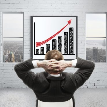 man looking at growth chart on poster